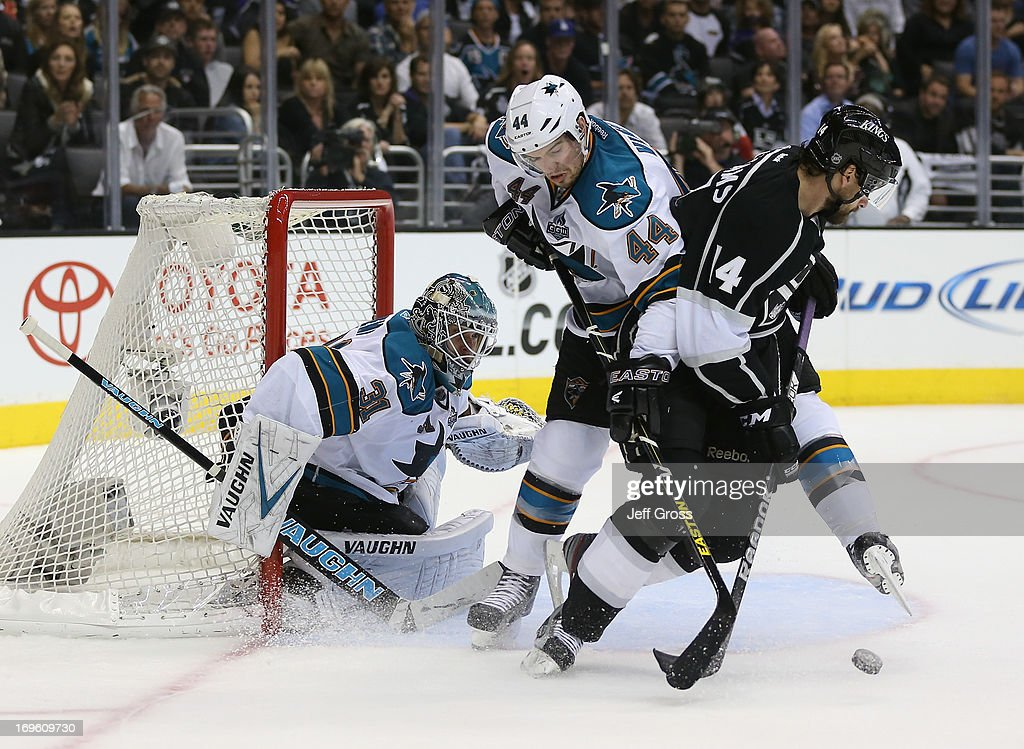 Goaltender <a gi-track='captionPersonalityLinkClicked' href=/galleries/search?phrase=Antti+Niemi&family=editorial&specificpeople=213913 ng-click='$event.stopPropagation()'>Antti Niemi</a> #31 of the San Jose Sharks defends, as <a gi-track='captionPersonalityLinkClicked' href=/galleries/search?phrase=Marc-Edouard+Vlasic&family=editorial&specificpeople=880807 ng-click='$event.stopPropagation()'>Marc-Edouard Vlasic</a> #44 of the Sharks and Justin Williams #14 of the Los Angeles Kings fight for the puck in the second period of Game Seven of the Western Conference Semifinals during the 2013 NHL Stanley Cup Playoffs at Staples Center on May 28, 2013 in Los Angeles, California. The Kings defeated the Sharks 2-1.