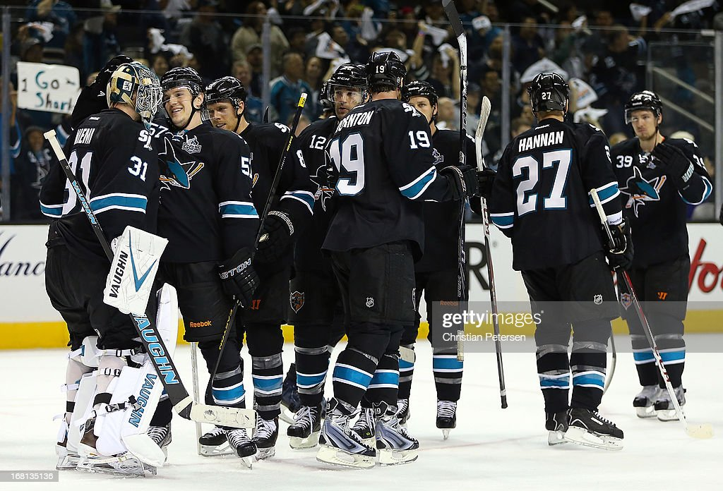 Goaltender Antti Niemi #31 of the San Jose Sharks is congratulated by teammates Tommy Wingels #57, Joe Pavelski #8 and Patrick Marleau #12 after defeating the Vancouver Canucks in Game Three of the Western Conference Quarterfinals during the 2013 NHL Stanley Cup Playoffs at HP Pavilion on May 5, 2013 in San Jose, California. The Sharks defeated the Canucks 5-2.