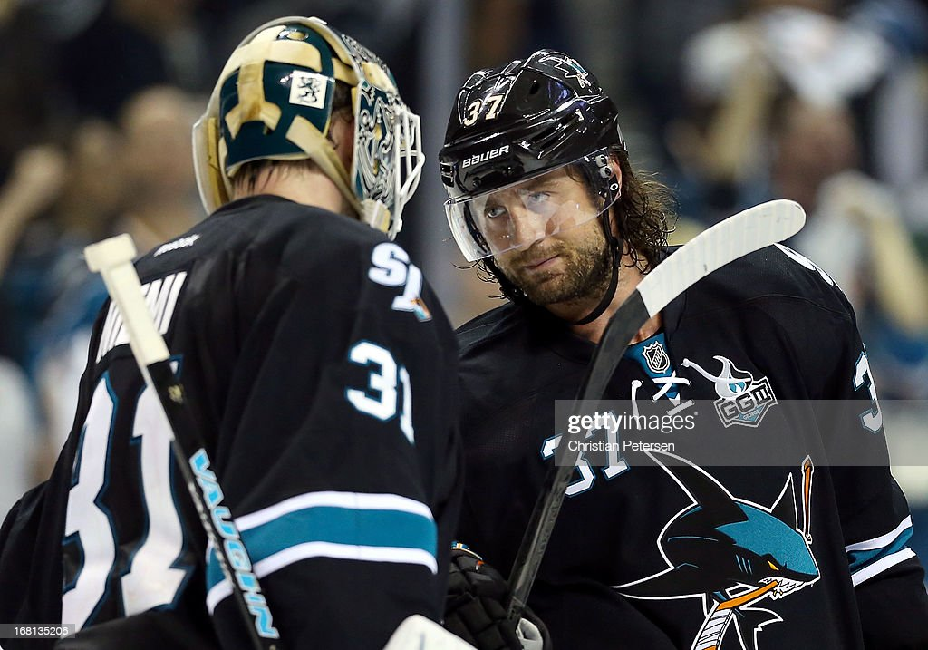 Goaltender Antti Niemi #31 of the San Jose Sharks is congratulated by Adam Burish #37 after defeating the Vancouver Canucks in Game Three of the Western Conference Quarterfinals during the 2013 NHL Stanley Cup Playoffs at HP Pavilion on May 5, 2013 in San Jose, California. The Sharks defeated the Canucks 5-2.