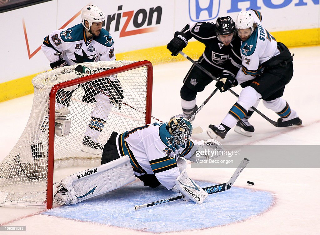 Goaltender <a gi-track='captionPersonalityLinkClicked' href=/galleries/search?phrase=Antti+Niemi&family=editorial&specificpeople=213913 ng-click='$event.stopPropagation()'>Antti Niemi</a> #31 of the San Jose Sharks looks to cover the loose puck as defenseman Brad Stuart #7 of the San Jose Sharks holds off a challenge by Mike Richards #10 of the Los Angeles Kings in the third period of Game Five of the Western Conference Semifinals during the 2013 NHL Stanley Cup Playoffs at Staples Center on May 23, 2013 in Los Angeles, California. The Kings defeated the Sharks 3-0.