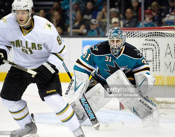 Goaltender Antti Niemi of the San Jose Sharks looks to defend his goal against Tomas Vincour of the Dallas Stars during an NHL hockey game at HP...
