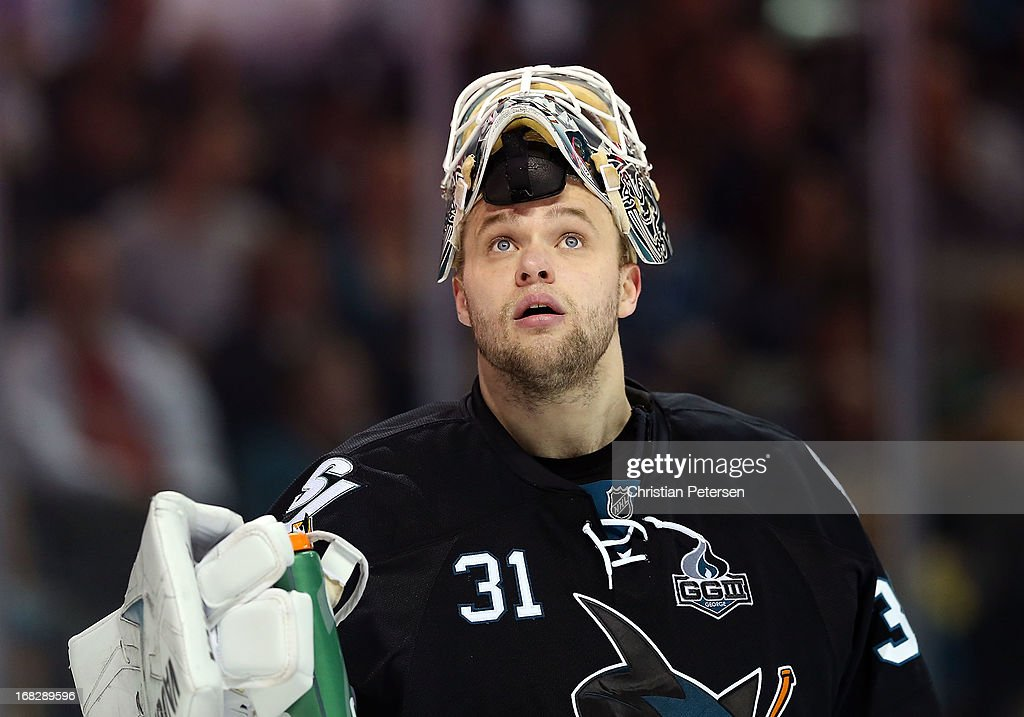 Goaltender <a gi-track='captionPersonalityLinkClicked' href=/galleries/search?phrase=Antti+Niemi&family=editorial&specificpeople=213913 ng-click='$event.stopPropagation()'>Antti Niemi</a> #31 of the San Jose Sharks looks up to the crowd in Game Four of the Western Conference Quarterfinals against the Vancouver Canucks during the 2013 NHL Stanley Cup Playoffs at HP Pavilion on May 7, 2013 in San Jose, California. The Sharks defeated the Canucks 4-3 to sweep the series 4 games to 0.