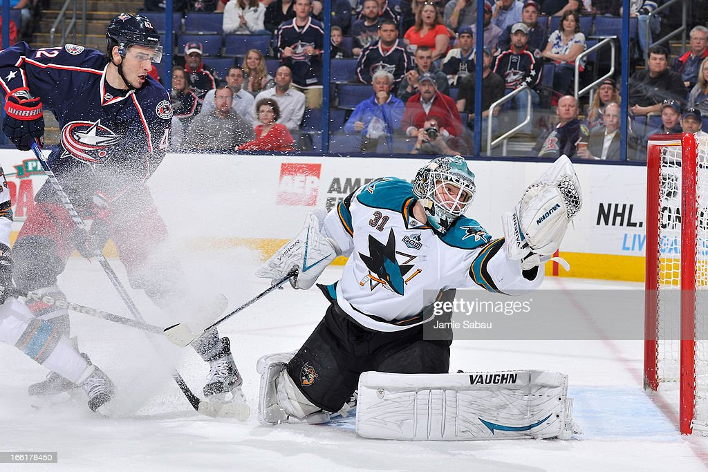 Goaltender <a gi-track='captionPersonalityLinkClicked' href=/galleries/search?phrase=Antti+Niemi&family=editorial&specificpeople=213913 ng-click='$event.stopPropagation()'>Antti Niemi</a> #31 of the San Jose Sharks makes a glove save during the first period on April 9, 2013 at Nationwide Arena in Columbus, Ohio.