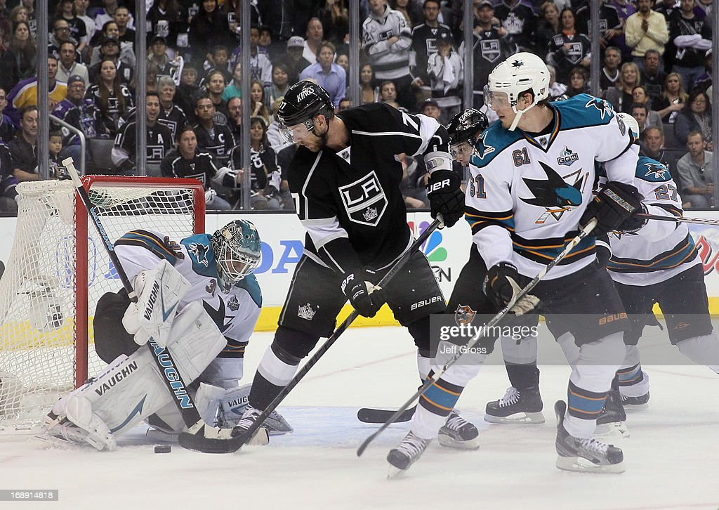 Goaltender <a gi-track='captionPersonalityLinkClicked' href=/galleries/search?phrase=Antti+Niemi&family=editorial&specificpeople=213913 ng-click='$event.stopPropagation()'>Antti Niemi</a> #31 of the San Jose Sharks makes a save on <a gi-track='captionPersonalityLinkClicked' href=/galleries/search?phrase=Jeff+Carter&family=editorial&specificpeople=227320 ng-click='$event.stopPropagation()'>Jeff Carter</a> #77 of the Los Angeles Kings, as Justin Braun #61 of the Sharks looks on in the third period of Game Two of the Western Conference Semifinals during the 2013 NHL Stanley Cup Playoffs at Staples Center on May 16, 2013 in Los Angeles, California. The Kings defeated the Sharks 4-3.