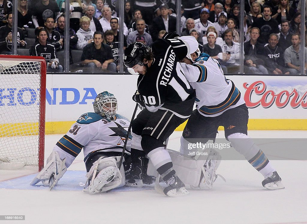 Goaltender <a gi-track='captionPersonalityLinkClicked' href=/galleries/search?phrase=Antti+Niemi&family=editorial&specificpeople=213913 ng-click='$event.stopPropagation()'>Antti Niemi</a> #31 of the San Jose Sharks makes a save on Mike Richards #10 of the Los Angeles Kings, as <a gi-track='captionPersonalityLinkClicked' href=/galleries/search?phrase=Scott+Hannan&family=editorial&specificpeople=203195 ng-click='$event.stopPropagation()'>Scott Hannan</a> #27 of the Sharks pursues the play in the third period of Game Two of the Western Conference Semifinals during the 2013 NHL Stanley Cup Playoffs at Staples Center on May 16, 2013 in Los Angeles, California. The Kings defeated the Sharks 4-3.