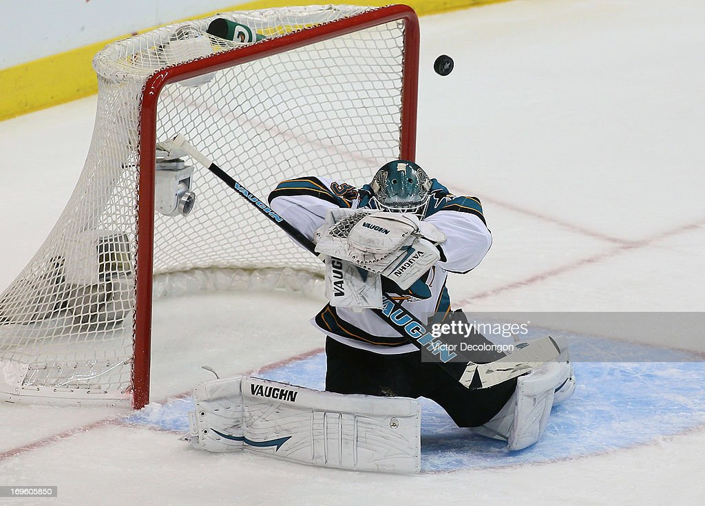 Goaltender <a gi-track='captionPersonalityLinkClicked' href=/galleries/search?phrase=Antti+Niemi&family=editorial&specificpeople=213913 ng-click='$event.stopPropagation()'>Antti Niemi</a> #31 of the San Jose Sharks takes a shot off his right shoulder in the first period of Game Seven of the Western Conference Semifinals against the Los Angeles Kings during the 2013 NHL Stanley Cup Playoffs at Staples Center on May 28, 2013 in Los Angeles, California.