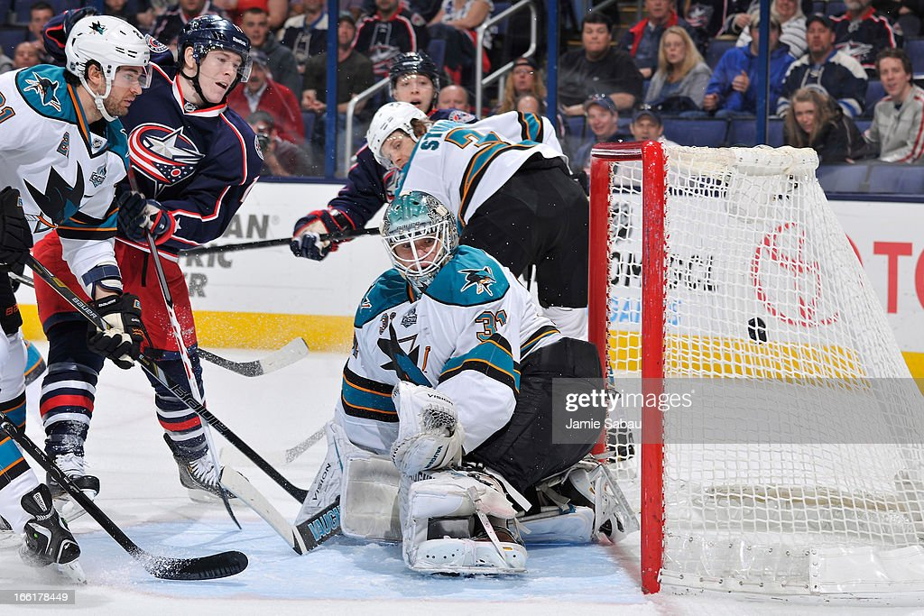 Goaltender Antti Niemi #31 of the San Jose Sharks watches as a shot taken Matt Calvert #11 of the Columbus Blue Jackets goes into the net during the first period on April 9, 2013 at Nationwide Arena in Columbus, Ohio.