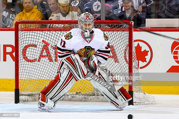 Goaltender Antti Raanta of the Chicago Blackhawks takes part in the pregame warm up prior to NHL action against the Winnipeg Jets on February 6 2015...