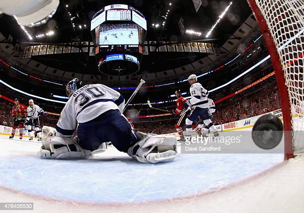 Goaltender Ben Bishop of the Tampa Bay Lightning lets in the puck on a shot by Brandon Saad of the Chicago Blackhawks during the third period of Game...