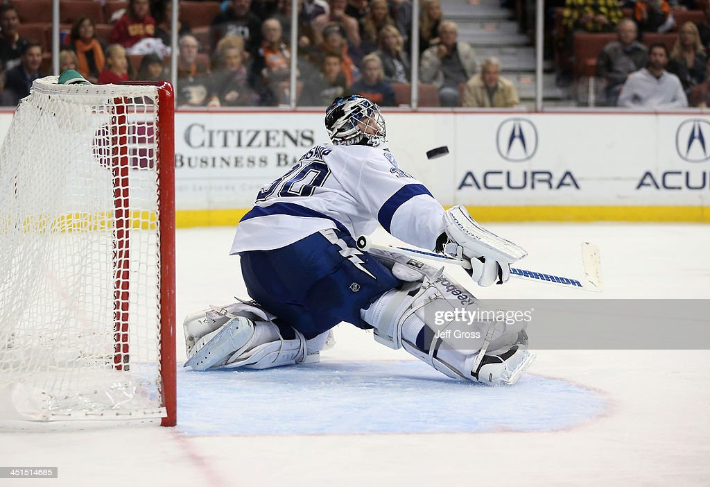 Goaltender <a gi-track='captionPersonalityLinkClicked' href=/galleries/search?phrase=Ben+Bishop&family=editorial&specificpeople=700137 ng-click='$event.stopPropagation()'>Ben Bishop</a> #30 of the Tampa Bay Lightning makes a save in the third period against the Anaheim Ducks at Honda Center on November 22, 2013 in Anaheim, California. The Ducks defeated the Lightning 1-0 in overtime.