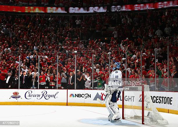 Goaltender Ben Bishop of the Tampa Bay Lightning reacts as the crowd cheers after giving up a goal to Duncan Keith of the Chicago Blackhawks during...