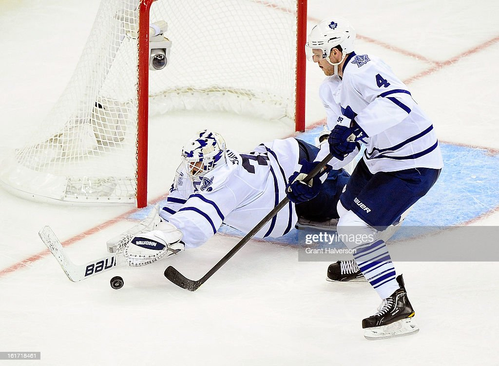 Goaltender <a gi-track='captionPersonalityLinkClicked' href=/galleries/search?phrase=Ben+Scrivens&family=editorial&specificpeople=7185205 ng-click='$event.stopPropagation()'>Ben Scrivens</a> #30 dives to cover up a rebound as teammate <a gi-track='captionPersonalityLinkClicked' href=/galleries/search?phrase=Cody+Franson&family=editorial&specificpeople=2125769 ng-click='$event.stopPropagation()'>Cody Franson</a> #4 of the Toronto Maple Leafs looks on during a loss to the Carolina Hurricanes at PNC Arena on February 14, 2013 in Raleigh, North Carolina. Carolina defeated Toronto, 3-1.