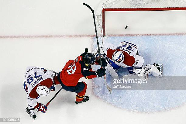 Goaltender Ben Scrivens of the Montreal Canadiens defends the net with the help of teammate Andrei Markov against Jaromir Jagr of the Florida...