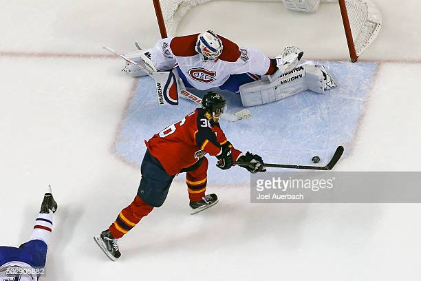 Goaltender Ben Scrivens of the Montreal Canadiens stops a shot by Jussi Jokinen of the Florida Panthers during second period action at the BBT Center...