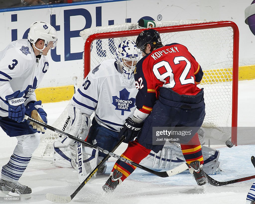 Goaltender <a gi-track='captionPersonalityLinkClicked' href=/galleries/search?phrase=Ben+Scrivens&family=editorial&specificpeople=7185205 ng-click='$event.stopPropagation()'>Ben Scrivens</a> #30 of the Toronto Maple Leafs stops a third period shot by <a gi-track='captionPersonalityLinkClicked' href=/galleries/search?phrase=Tomas+Kopecky&family=editorial&specificpeople=2234349 ng-click='$event.stopPropagation()'>Tomas Kopecky</a> #82 of the Florida Panthers at the BB&T Center on February 18, 2013 in Sunrise, Florida. The Maple Leafs defeated the Panthers 3-0.