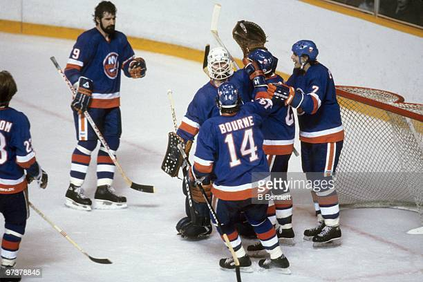 Goaltender Billy Smith of the New York Islanders and his teammates celebrate after winning Game 3 of the 1982 Stanley Cup Finals against the...