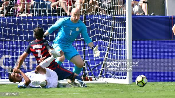Goaltender Brad Guzan of USA looks at the ball as teammate Omar Gonzalez defends in front of the net during the first half of a CONCACAF Gold Cup...