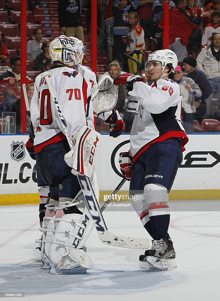 Goaltender Braden Holtby #70 is congratulated by <a gi-track='captionPersonalityLinkClicked' href=/galleries/search?phrase=Marcus+Johansson&family=editorial&specificpeople=4247883 ng-click='$event.stopPropagation()'>Marcus Johansson</a> #90 of the Washington Capitals at the conclusion of the game against the Florida Panthers at the BB&T Center on April 6, 2013 in Sunrise, Florida. The Capitals defeated the Panthers 4-3.