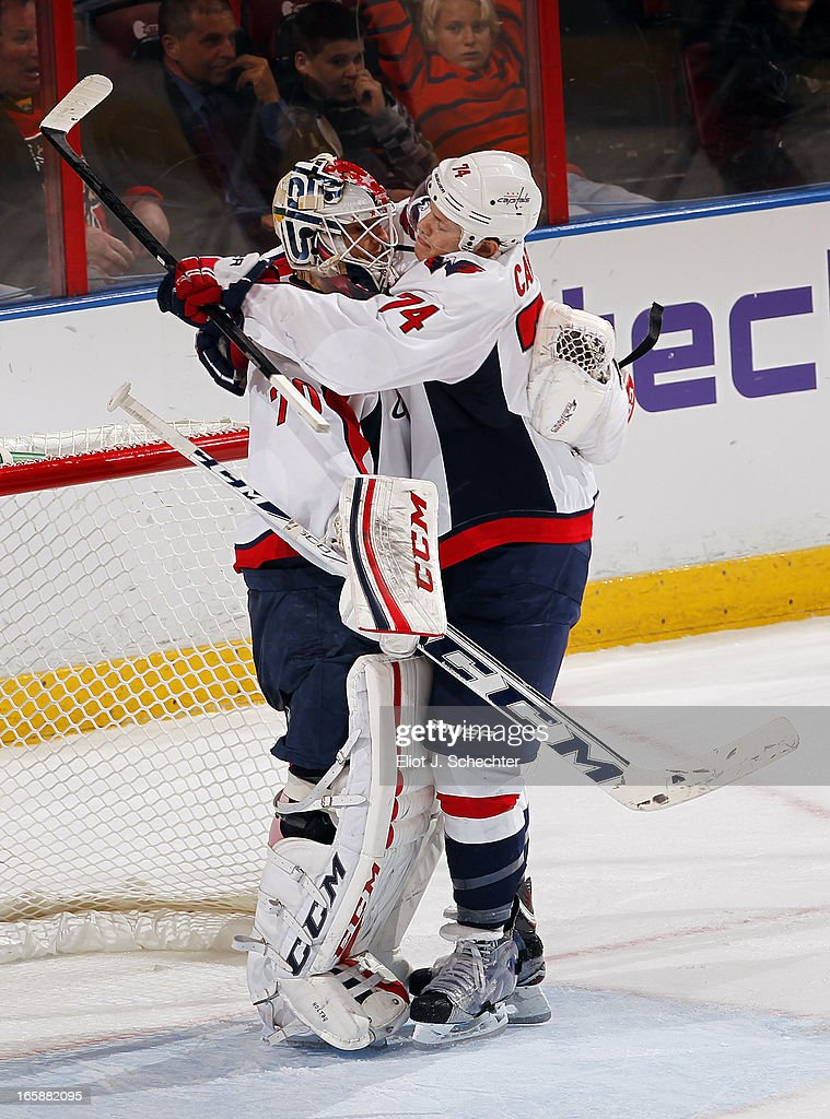 Goaltender <a gi-track='captionPersonalityLinkClicked' href=/galleries/search?phrase=Braden+Holtby&family=editorial&specificpeople=5370964 ng-click='$event.stopPropagation()'>Braden Holtby</a> #70 of the Washington Capitals celebrates their win with teammate John Carlson #74 against the Florida Panthers at the BB&T Center on April 6, 2013 in Sunrise, Florida.