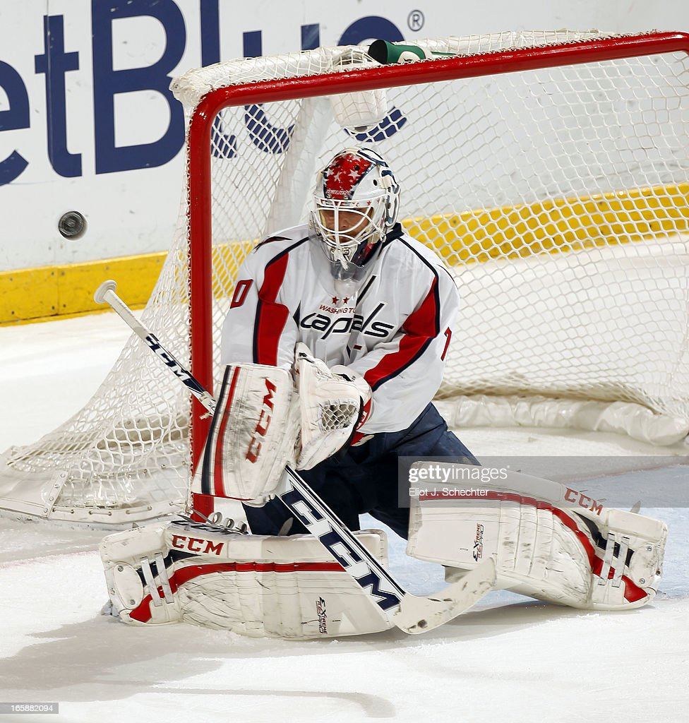 Goaltender <a gi-track='captionPersonalityLinkClicked' href=/galleries/search?phrase=Braden+Holtby&family=editorial&specificpeople=5370964 ng-click='$event.stopPropagation()'>Braden Holtby</a> #70 of the Washington Capitals defends the net against the Florida Panthers at the BB&T Center on April 6, 2013 in Sunrise, Florida.