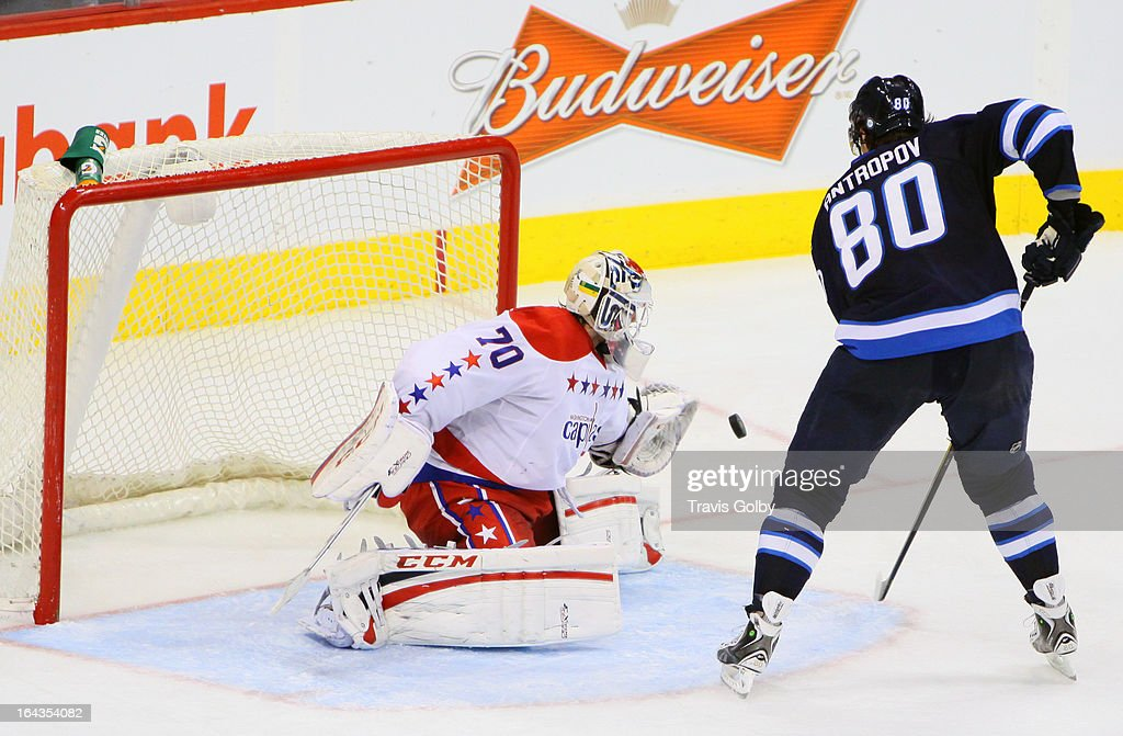 Goaltender Braden Holtby #70 of the Washington Capitals deflects the puck away from the net on a shot by Nik Antropov #80 of the Winnipeg Jets during third period action at the MTS Centre on March 22, 2013 in Winnipeg, Manitoba, Canada.