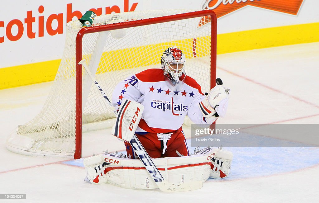 Goaltender <a gi-track='captionPersonalityLinkClicked' href=/galleries/search?phrase=Braden+Holtby&family=editorial&specificpeople=5370964 ng-click='$event.stopPropagation()'>Braden Holtby</a> #70 of the Washington Capitals makes a glove save during third-period action against the Winnipeg Jets at the MTS Centre on March 22, 2013 in Winnipeg, Manitoba, Canada.