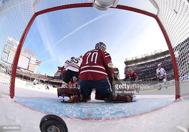 Goaltender Braden Holtby of the Washington Capitals reacts after a goal by Patrick Sharp of the Chicago Blackhawks as Jonathan Toews of the Chicago...