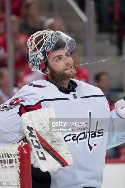 Goaltender Braden Holtby of the Washington Capitals spits out water during an NHL game against the Detroit Red Wings at Little Caesars Arena on...