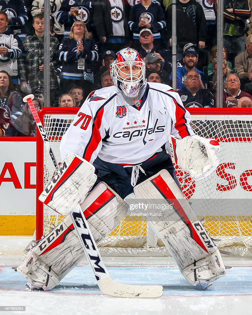Goaltender <a gi-track='captionPersonalityLinkClicked' href=/galleries/search?phrase=Braden+Holtby&family=editorial&specificpeople=5370964 ng-click='$event.stopPropagation()'>Braden Holtby</a> #70 of the Washington Capitals takes part in the pre-game warm up prior to NHL action against the Winnipeg Jets on March 21, 2015 at the MTS Centre in Winnipeg, Manitoba, Canada.