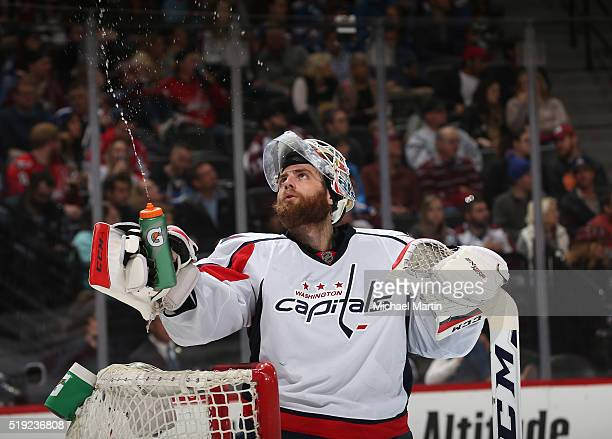 Goaltender Braden Holtby of the Washington Captitals squirts water out of his water bottle during a break in the action against the Colorado...