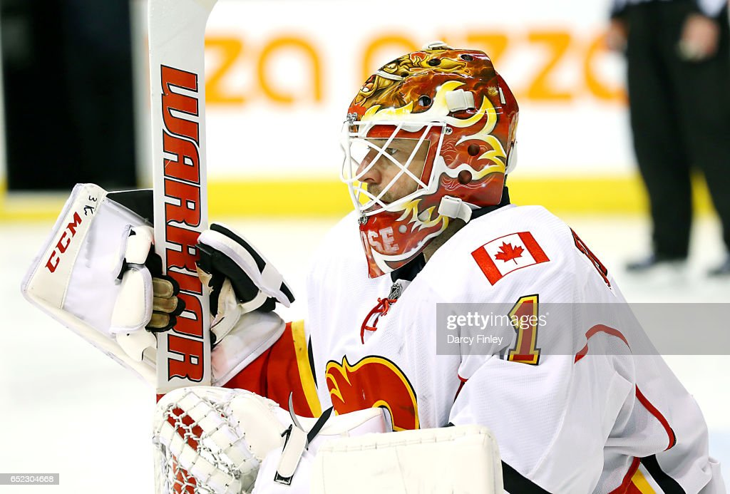 Goaltender Brian Elliott #1 of the Calgary Flames looks on during a third period stoppage in play against the Winnipeg Jets at the MTS Centre on March 11, 2017 in Winnipeg, Manitoba, Canada.