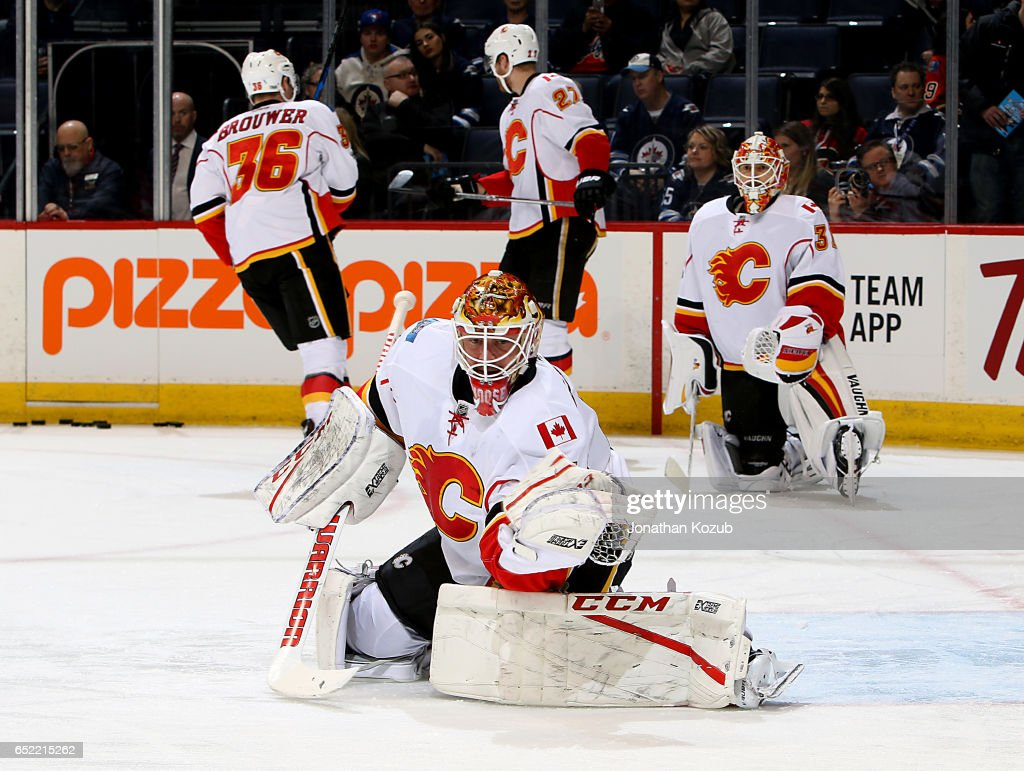 Goaltender Brian Elliott #1 of the Calgary Flames takes part in the pre-game warm up prior to NHL action against the Winnipeg Jets at the MTS Centre on March 11, 2017 in Winnipeg, Manitoba, Canada.