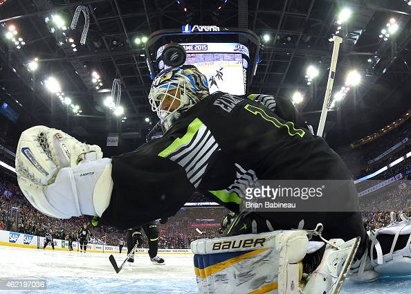 Goaltender Brian Elliott of the St Louis Blues and Team Foligno can't make the save on a shot for a goal by Rick Nash of the New York Rangers and...