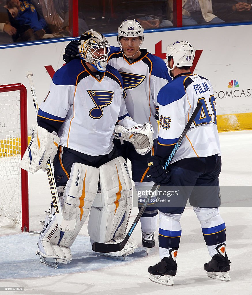 Goaltender <a gi-track='captionPersonalityLinkClicked' href=/galleries/search?phrase=Brian+Elliott&family=editorial&specificpeople=687032 ng-click='$event.stopPropagation()'>Brian Elliott</a> #1 of the St Louis Blues and teammates <a gi-track='captionPersonalityLinkClicked' href=/galleries/search?phrase=Ian+Cole&family=editorial&specificpeople=4361308 ng-click='$event.stopPropagation()'>Ian Cole</a> #28 and <a gi-track='captionPersonalityLinkClicked' href=/galleries/search?phrase=Roman+Polak&family=editorial&specificpeople=2109482 ng-click='$event.stopPropagation()'>Roman Polak</a> #46 celebrate their 4-0 shutout of the Florida Panthers at the BB&T Center on November 1, 2013 in Sunrise, Florida.