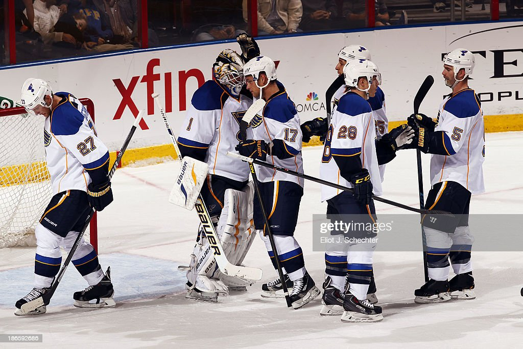 Goaltender <a gi-track='captionPersonalityLinkClicked' href=/galleries/search?phrase=Brian+Elliott&family=editorial&specificpeople=687032 ng-click='$event.stopPropagation()'>Brian Elliott</a> #1 of the St Louis Blues and teammates celebrate their 4-0 shutout of the Florida Panthers at the BB&T Center on November 1, 2013 in Sunrise, Florida.