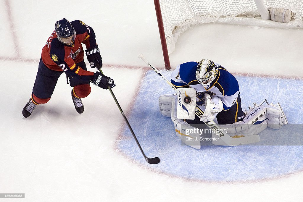 Goaltender Brian Elliott #1 of the St Louis Blues blocks a shot by Kris Versteeg #32 of the Florida Panthers at the BB&T Center on November 1, 2013 in Sunrise, Florida.