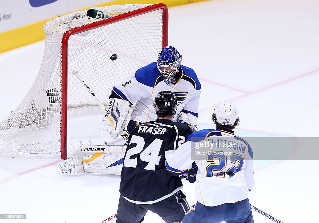 Goaltender <a gi-track='captionPersonalityLinkClicked' href=/galleries/search?phrase=Brian+Elliott&family=editorial&specificpeople=687032 ng-click='$event.stopPropagation()'>Brian Elliott</a> #1 of the St. Louis Blues can't make the save on a shot for a goal by Drew Doughty #8 of the Los Angeles Kings (not in photo) in the first period of Game Six of the Western Conference Quarterfinals during the 2013 NHL Stanley Cup Playoffs at Staples Center on May 10, 2013 in Los Angeles, California. The Kings defeated the Blues 2-1 to win the series 4 games to 2 to advance to the Western Conference Semifinal.
