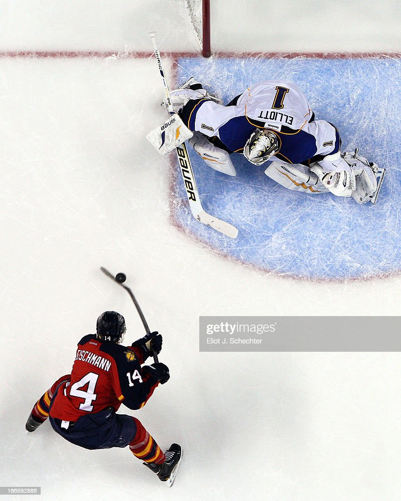 Goaltender <a gi-track='captionPersonalityLinkClicked' href=/galleries/search?phrase=Brian+Elliott&family=editorial&specificpeople=687032 ng-click='$event.stopPropagation()'>Brian Elliott</a> #1 of the St Louis Blues defends the net against <a gi-track='captionPersonalityLinkClicked' href=/galleries/search?phrase=Tomas+Fleischmann&family=editorial&specificpeople=554398 ng-click='$event.stopPropagation()'>Tomas Fleischmann</a> #14 of the Florida Panthers at the BB&T Center on November 1, 2013 in Sunrise, Florida.