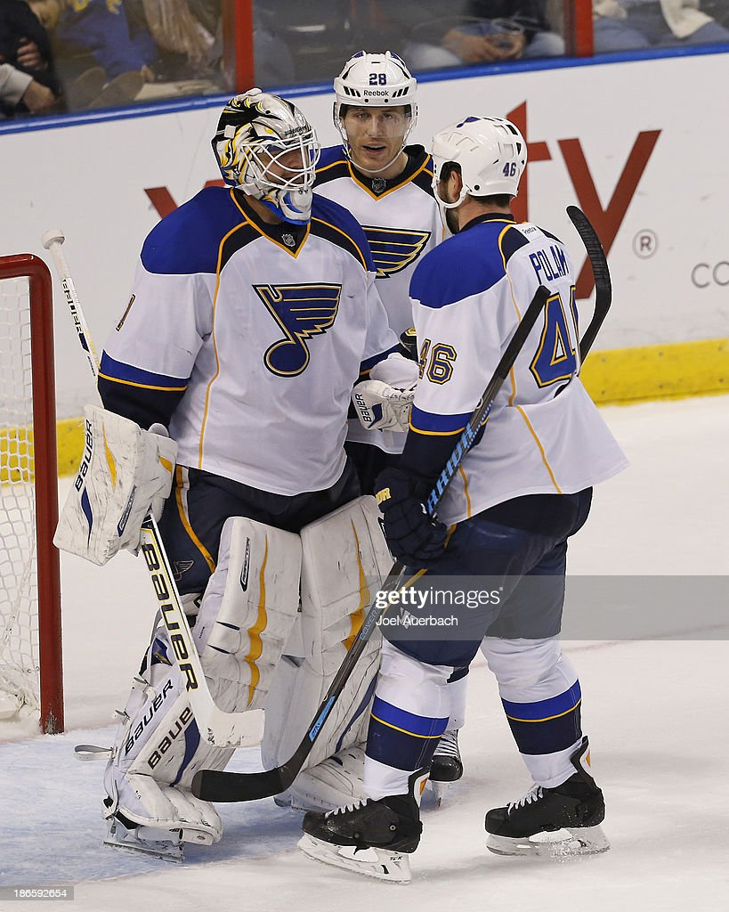 Goaltender <a gi-track='captionPersonalityLinkClicked' href=/galleries/search?phrase=Brian+Elliott&family=editorial&specificpeople=687032 ng-click='$event.stopPropagation()'>Brian Elliott</a> #1 of the St. Louis Blues is congratulated by teammates <a gi-track='captionPersonalityLinkClicked' href=/galleries/search?phrase=Roman+Polak&family=editorial&specificpeople=2109482 ng-click='$event.stopPropagation()'>Roman Polak</a> #46 and <a gi-track='captionPersonalityLinkClicked' href=/galleries/search?phrase=Ian+Cole&family=editorial&specificpeople=4361308 ng-click='$event.stopPropagation()'>Ian Cole</a> #28 after the game against the Florida Panthers at the BB&T Center on November 1, 2013 in Sunrise, Florida. The Blues defeated the Panthers 4-0.