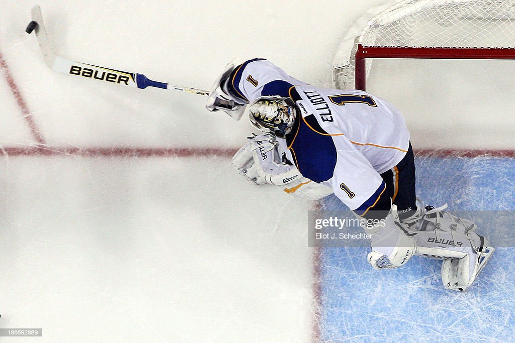 Goaltender <a gi-track='captionPersonalityLinkClicked' href=/galleries/search?phrase=Brian+Elliott&family=editorial&specificpeople=687032 ng-click='$event.stopPropagation()'>Brian Elliott</a> #1 of the St Louis Blues sends the puck back around against the Florida Panthers at the BB&T Center on November 1, 2013 in Sunrise, Florida.
