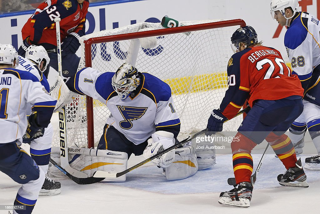 Goaltender Brian Elliott #1 of the St. Louis Blues stops a shot by Sean Bergenheim #20 of the Florida Panthers at the BB&T Center on November 1, 2013 in Sunrise, Florida. The Blues defeated the Panthers 4-0.