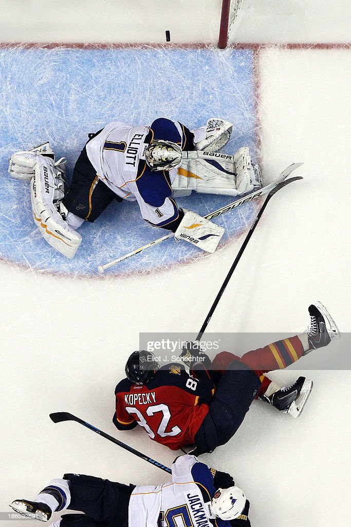 Goaltender <a gi-track='captionPersonalityLinkClicked' href=/galleries/search?phrase=Brian+Elliott&family=editorial&specificpeople=687032 ng-click='$event.stopPropagation()'>Brian Elliott</a> #1 of the St Louis Blues stops a shot by <a gi-track='captionPersonalityLinkClicked' href=/galleries/search?phrase=Tomas+Kopecky&family=editorial&specificpeople=2234349 ng-click='$event.stopPropagation()'>Tomas Kopecky</a> #82 of the Florida Panthers at the BB&T Center on November 1, 2013 in Sunrise, Florida.