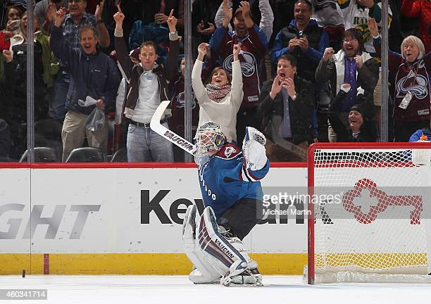 Goaltender Calvin Pickard of the Colorado Avalanche celebrates his first NHL shootout win against the Winnipeg Jets at the Pepsi Center on December...