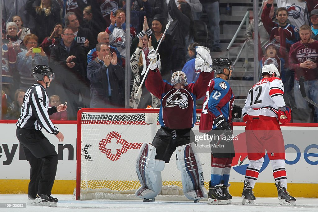 Goaltender Calvin Pickard #31 of the Colorado Avalanche celebrates victory with teammate Jarome Iginla #12 as Eric Staal #12 of the Carolina Hurricanes reacts at the Pepsi Center on November 22, 2014 in Denver, Colorado. The Avalanche defeated the Hurricanes 4-3.