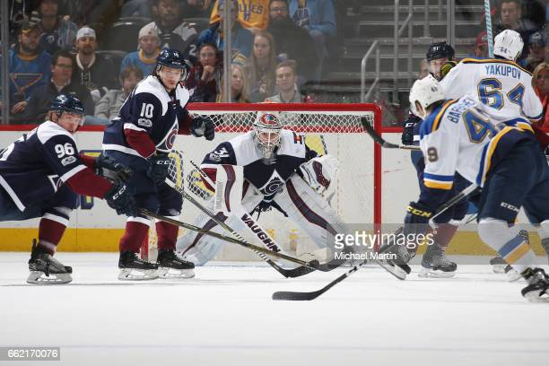 Goaltender Calvin Pickard of the Colorado Avalanche looks to makes a save against Ivan Barbashev of the St Louis Blues at the Pepsi Center on March...