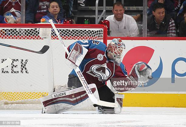 Goaltender Calvin Pickard of the Colorado Avalanche makes a glove save against the Nashville Predators at the Pepsi Center on March 05 2016 in Denver...