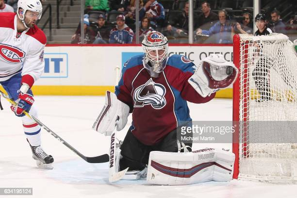 Goaltender Calvin Pickard of the Colorado Avalanche makes a glove save against the Montreal Canadiens at the Pepsi Center on February 7 2017 in...
