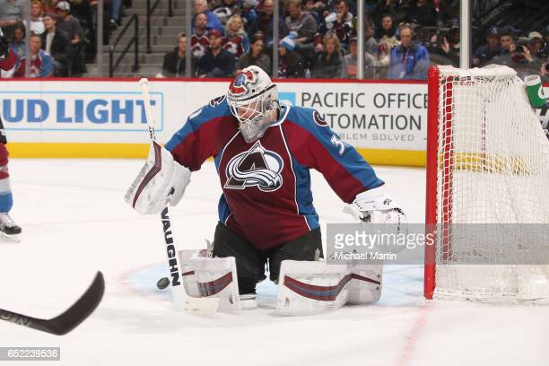 Goaltender Calvin Pickard of the Colorado Avalanche makes a pad save against the Ottawa Senators at the Pepsi Center on March 11 2017 in Denver...