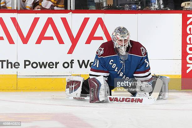 Goaltender Calvin Pickard of the Colorado Avalanche stretches prior to the game against the Dallas Stars at the Pepsi Center on November 29 2014 in...