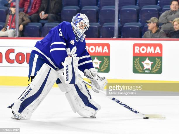 Goaltender Calvin Pickard of the Toronto Marlies looks to play the puck during the warmup prior to the AHL game against the Laval Rocket at Place...